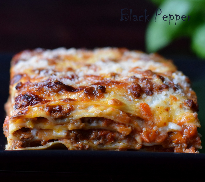 Traditional Lasagna Bolognese recipe with meat and creamy white sauce and parmesan.