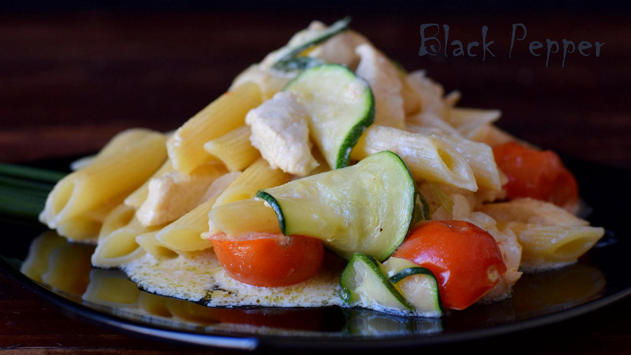 A simple pasta recipe with chicken breast, stewed vegetables with creamy sauce.