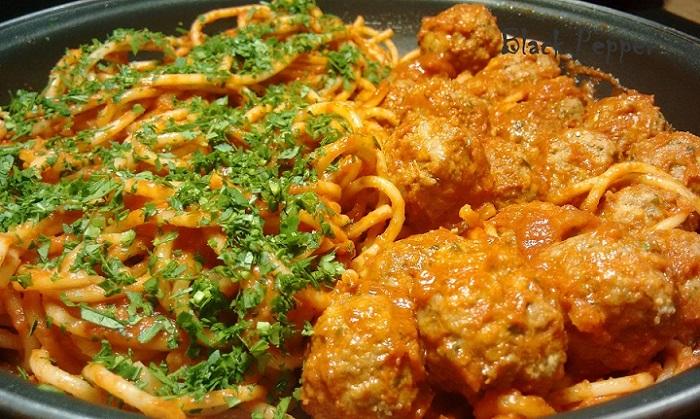 Italian style spaghetti pasta with meatballs with tomato sauce