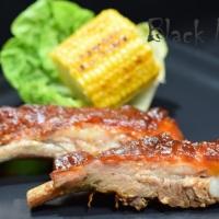 Свиные рёбрышки в духовке с соусом барбекю