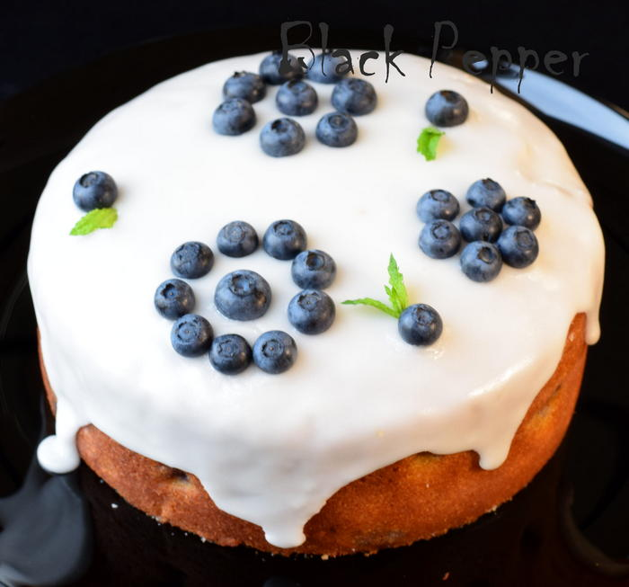 cake with blueberries and sweet sugar icing