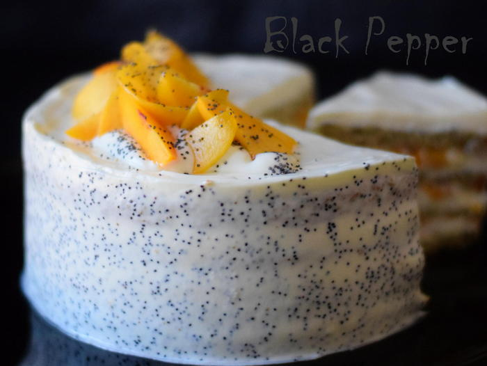 Sponge poppy seed peach cake with cream and peaches flambe'