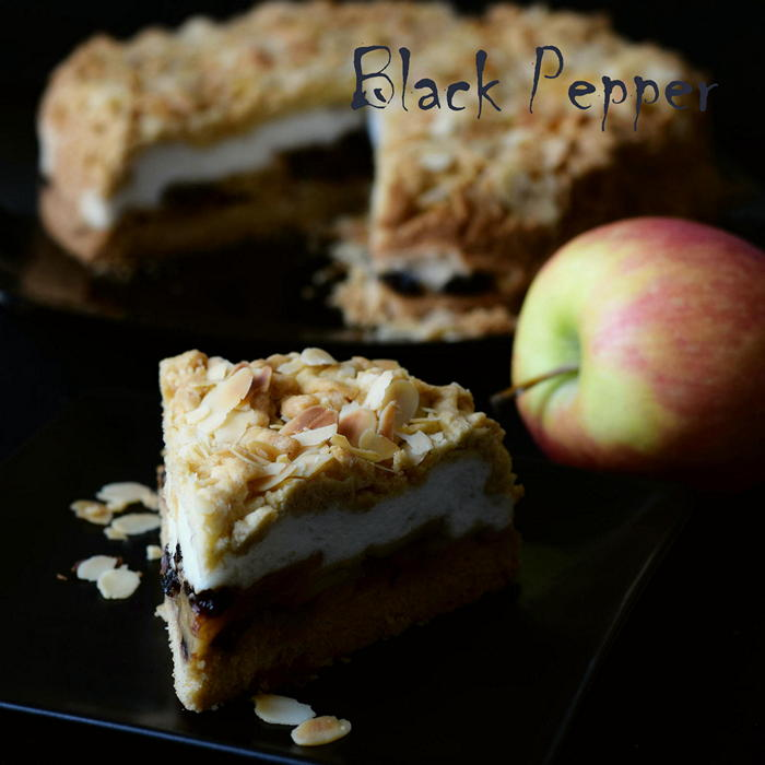 Apple meringue tart with prunes and almond