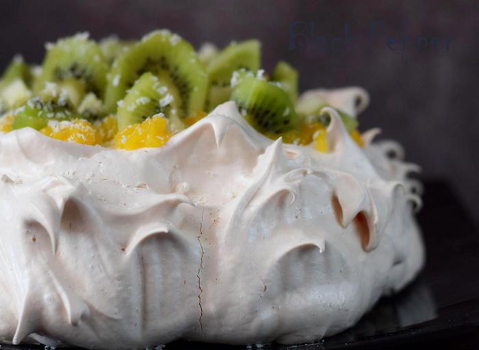 A snow-white Pavlova meringue cake with fragrant lemon curd and fresh kiwi
