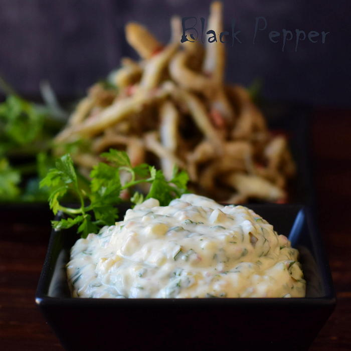The famous Tartar sauce with aromatic herbs and pickles